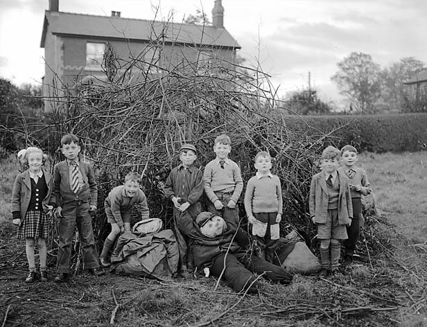 Children in England prepare for the Guy Fawkes bonfire